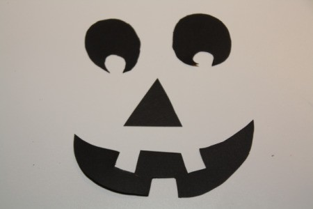 Cut Out Black Paper in Jack-O-Lantern Face